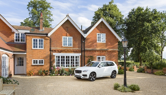 brick house with car in front